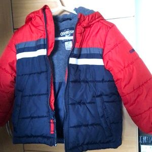 A toddler winter coat with hood .